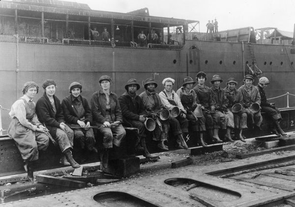 29th May 1919: Women rivet heaters and passers on ship construction work in the Navy Yard at Puget Sound, Seattle, Washington