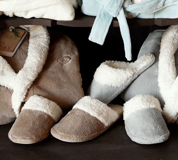 "<a href=""http://www.potterybarn.com/products/cozy-sherpa-slippers/"" target=""_blank"">Pottery Barn, $17.99 </a>"