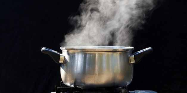 steam on pot in kitchen