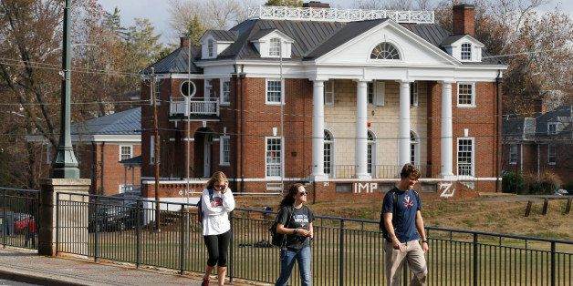 University of Virginia students walk to campus past the Phi Kappa Psi fraternity house at the University of Virginia in Charl
