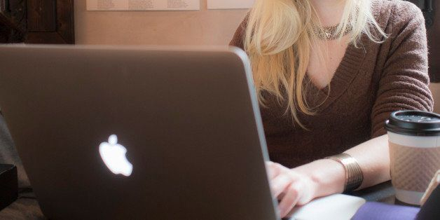a woman working intensely at her laptop