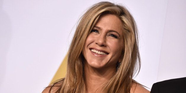 Jennifer Aniston poses in the press room at the Oscars on Sunday, Feb. 22, 2015, at the Dolby Theatre...