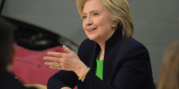 Hillary Rodham Clinton participates in a roundtable discussion with students and educators during a campaign event at the  Ki