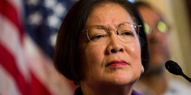 WASHINGTON, DC - DECEMBER 10: Sen. Mazie Hirono (D-HI) listens to a question during a news conference to discuss U.S. Preside