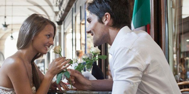 Caucasian man giving girlfriend a rose