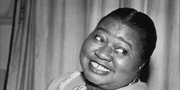 """Hattie McDaniel plays a tune as she portrays the title role of """"Beulah"""" in the CBS Radio Network's comedy series in New York"""