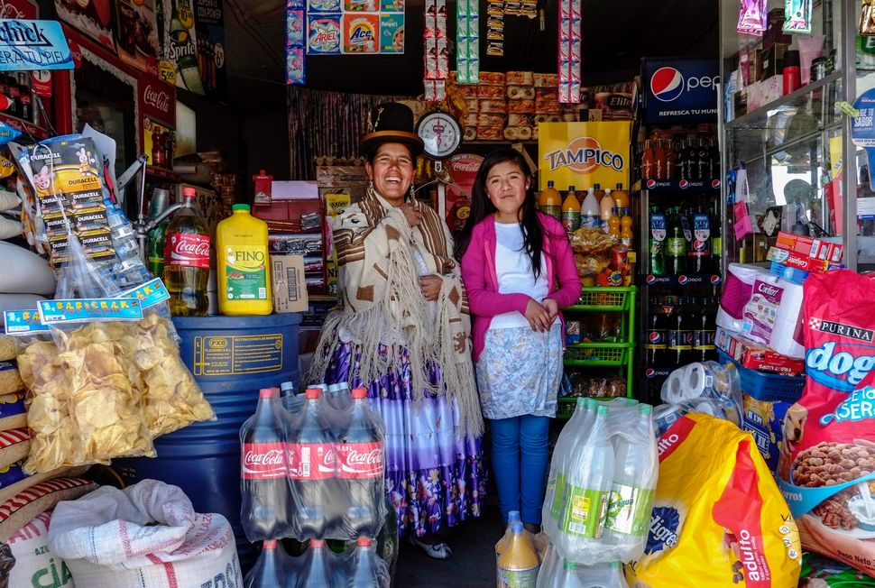 Lucia Mayta, 43, and her daughter Luz Cecilia, 12, pose for a photograph inside their bodega in La Paz, Bolivia on February 2