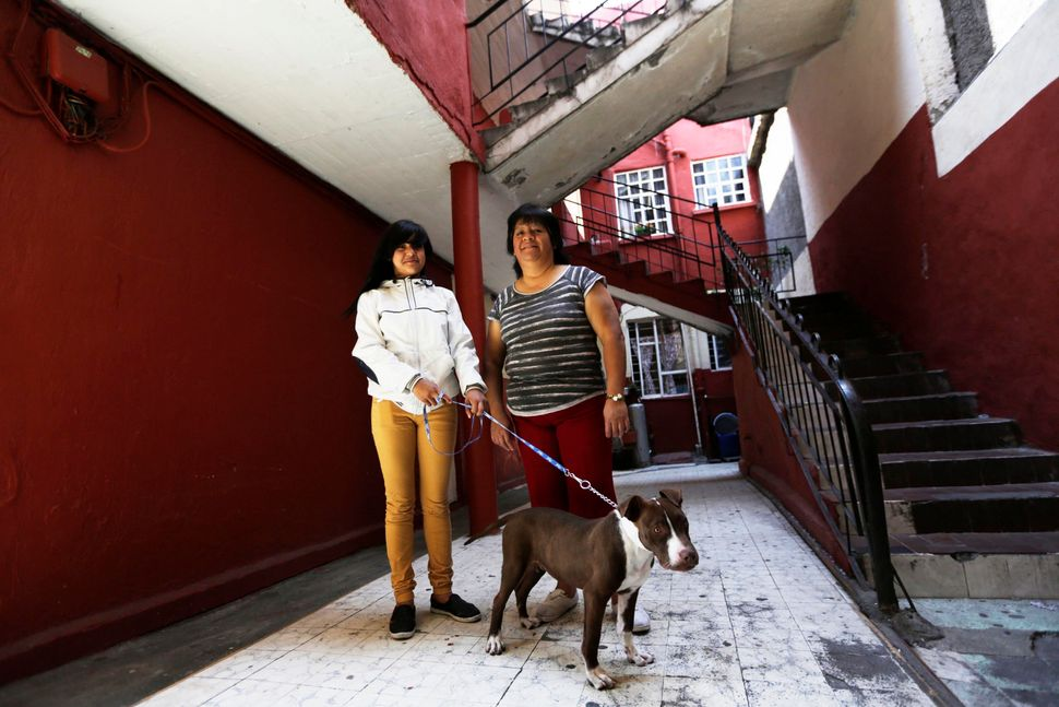 Rosaura Realsola, 51, poses for a photograph with her daughter Alexandra Yamileth, 13, in front of their home in Tepito in Me