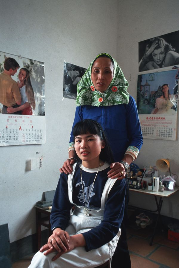 Eighteen-year-old Siu Ye and her mother in Da Zhou village in China.