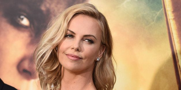 """Charlize Theron arrives at the Los Angeles premiere of """"Mad Max: Fury Road"""" at the TCL Chinese Theatre on Thursday, May 7, 20"""
