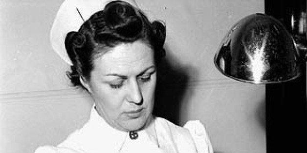 <b>Title / Titre :</b> Female nurse Cecile Dumas bathes and dresses workman Tom Heard's eye at the Arvida Aluminum Company o