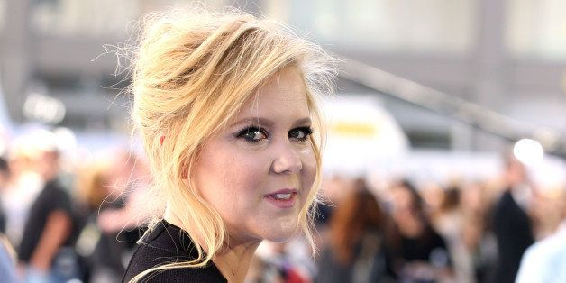 Amy Schumer arrives at the MTV Movie Awards at the Nokia Theatre on Sunday, April 12, 2015, in Los Angeles....