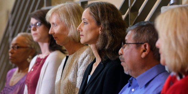 Members of the Austin city council listen to city manager Marc Ott during a news conference at City Hall, Wednesday, May 13,
