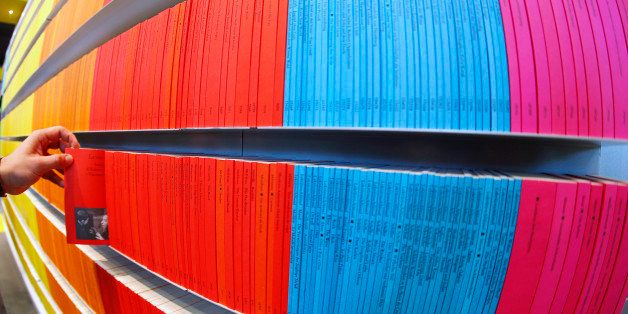 Colorful small books are seen on a shelf on the first day of the Book Fair in Frankfurt, Germany, Wednesday, Oct. 10, 2012. N