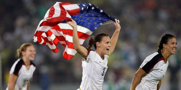The United States' Christie Rampone, center, Shannon Boxx, right, and Lori Chalupny, celebrate after beating Brazil 1-0 in th