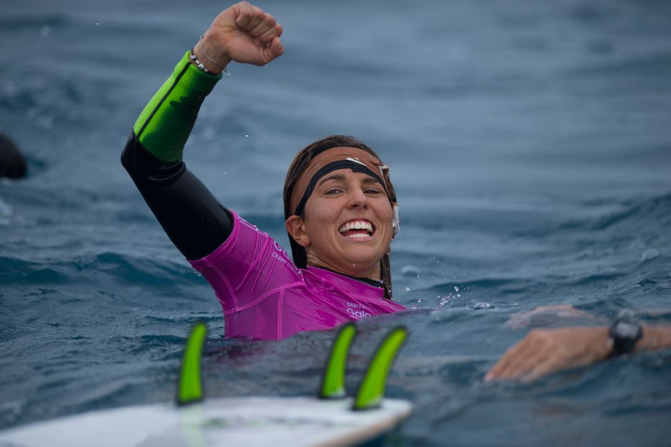 Sally Fitzgibbons celebrates her win at the Fiji Womens Pro with a busted eardrum.