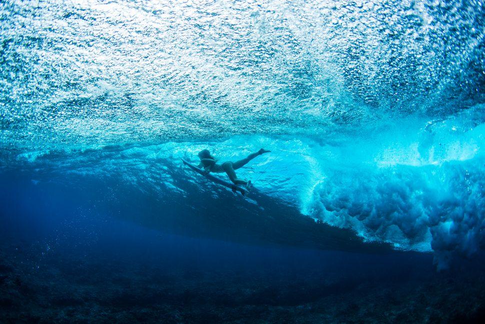 Nikki Van Dijk below the waves at Cloudbreak.