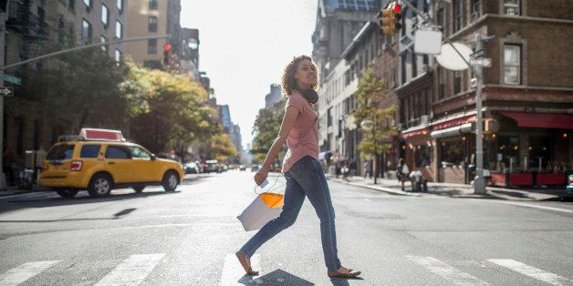 Woman shopping in NYC and walking on the street