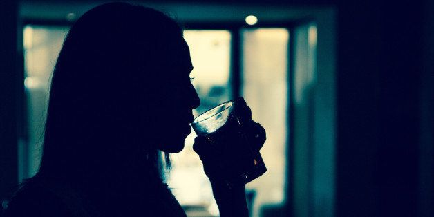 Silhouette of girl who is drinking