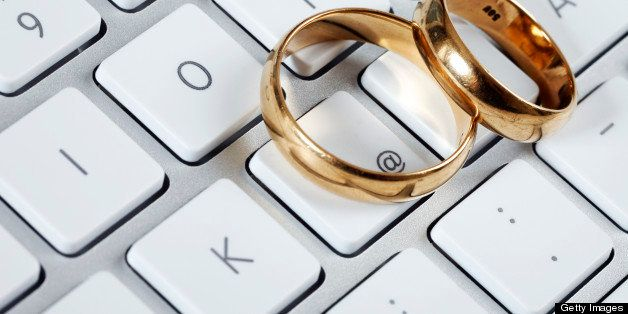 Wedding Rings on Computer Keyboard as Online Dating Concept.