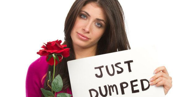 woman holding a sign that says 'just dumped' as a relationship break up concept