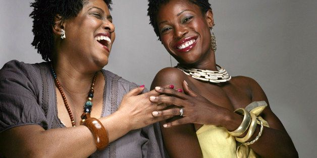 Portrait of happy mature and young African American women, studio shot