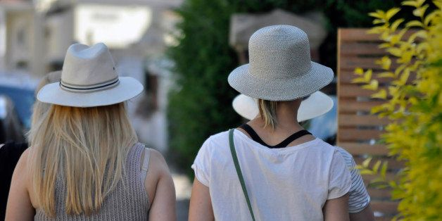 Ladies summer hats on parade in the streets of suburban.