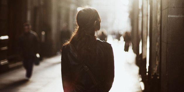 Girl walking down misty street