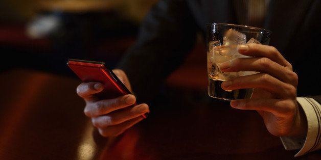 Bar,Japan,Kyoto,smart phoneMan is relaxing in the bar