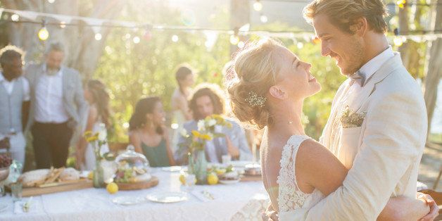Young couple dancing during wedding reception in domestic garden