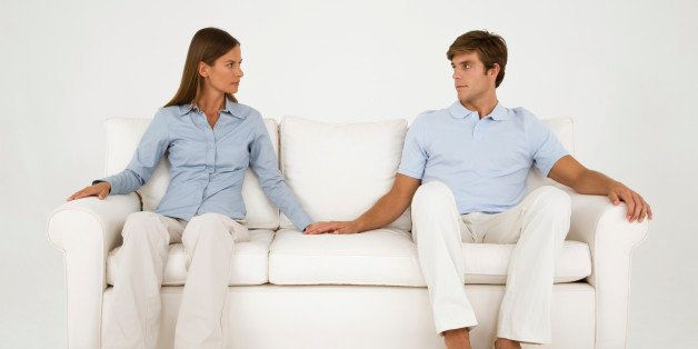 Couple holding hands on couch
