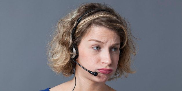 young fed up female professional working for a call center