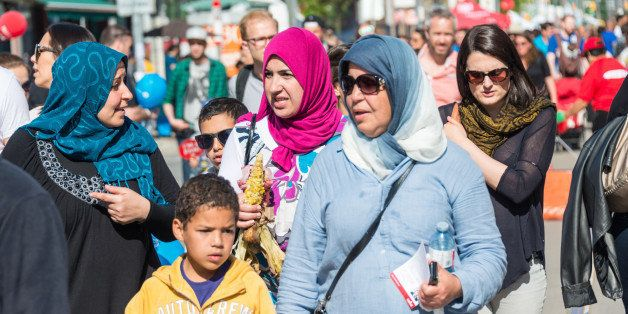 LITTLE PORTUGAL, TORONTO, ONTARIO, CANADA - 2015/06/06: Islam women wearing hijab in North American city, Multicultural city