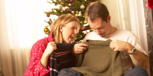 Couple opening christmas gifts