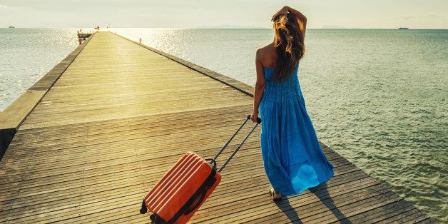 young woman with suitcase...