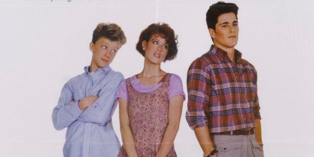 A poster for John Hughes' 1984 romantic comedy 'Sixteen Candles' starring (L-R) Anthony Michael Hall, Molly Ringwald, and Mic