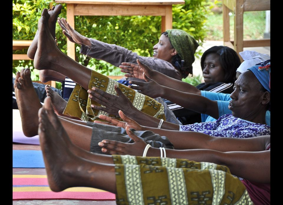 Women do Ashtanga stretches with Project Air in Kigali, Rwanda.