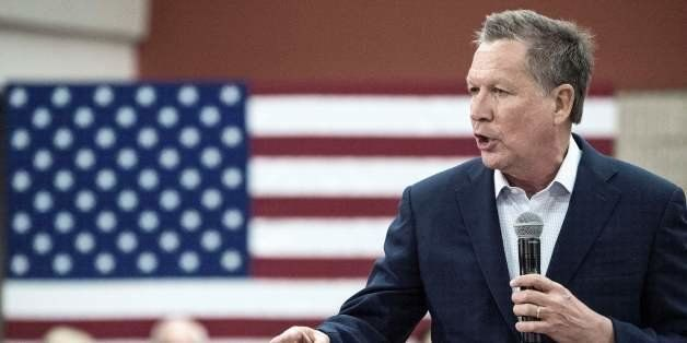 Republican presidential hopeful Ohio Governor John Kasich delivers campaign remarks to supporters February 22, 2016, at Georg