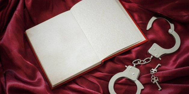 Book and handcuffs with keys