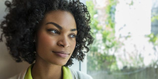 Woman looking thoughtfully out the window