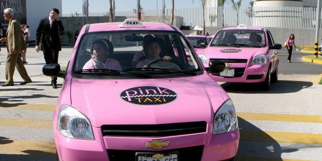 TO GO WITH AFP STORY - A female taxi driver powers her 'Pink Taxi' --to be used exclusively by women-- in Puebla, on October