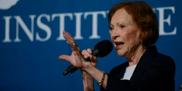 ASPEN, CO - JUNE 23:  Former First Lady Rosalynn Carter speaks with President Jimmy Carter and Aspen Institute president and