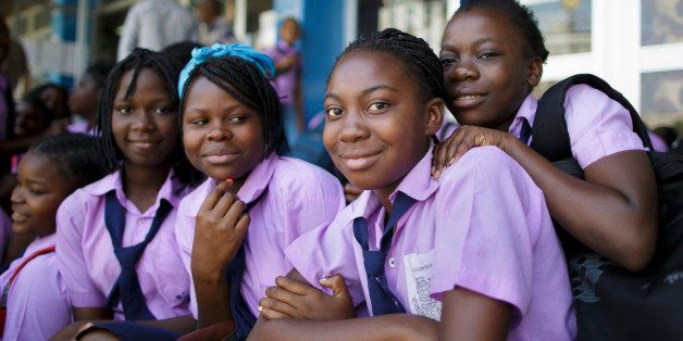 Beira, Mozambique - September 29: Students in school uniforms posing for a photo on September 29, 2015 in Beira, Mozambique.