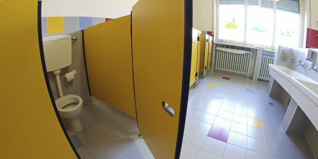 Yellow door opened into bathrooms with sinks of a nursery