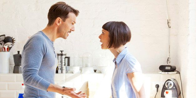 adult heterosexual couple quarreling at home