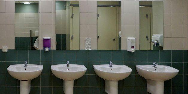 A row of basins in a public toilet