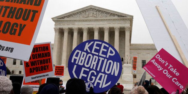 Pro-abortion rights signs are seen during the March for Life 2016, in front of the U.S. Supreme Court,  Friday, Jan. 22, 2016