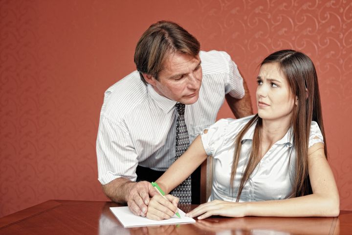Manager showing inappropriate behavior towards young female co-worker