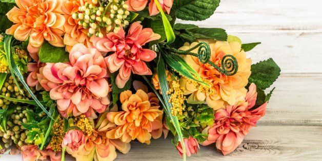 Colorful flowers bouquet on wood background. Flowers backgrounds.