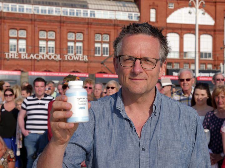 Michael Moseley holding a bottle of the placebo pills.